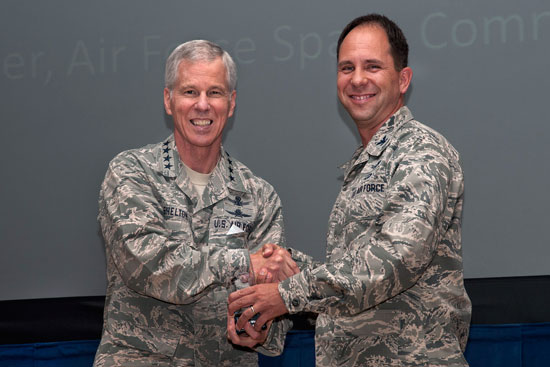 (U.S. Air Force photo/Craig Denton)  PETERSON AIR FORCE BASE, Colo. – General William L. Shelton (left), Air Force Space Command commander, presents the 2013 General Thomas S. Moorman Jr. Award to Col. John E. Shaw, 21st Space Wing commander, Aug. 4 at the 21 SW commander's call. The award recognizes Air Force Space Command's best operational wing.