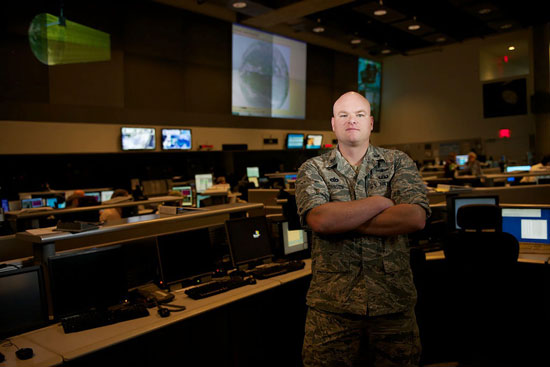 U.S. Air Force photo/Senior Airman Alexander W. Riedel Capt. Tyson Johnson stands in the satellite operations center Sept. 25, 2014, at the National Oceanic and Atmospheric Administration's satellite operations facility in Suitland, Md. Johnson is the ground flight commander with Detachment 1, 50th Space Operations Group. The geographically separated unit manages the Defense Meteorological Satellite Program – the only weather satellite system in the DOD – in cooperation with NOAA engineers and satellite operators. The system supplies weather data to the Air Force Weather agency as well as military and civilian organizations around the world.