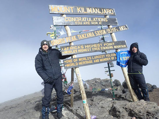 U.S. Air Force/courtesy photo Capt. Rodrigo Ocampo, 4th Space Operations Squadron spacecraft engineer, shows his 4 SOPS pride after reaching the summit of Mount Kilimanjaro along with his friend John Gaebler in early October.