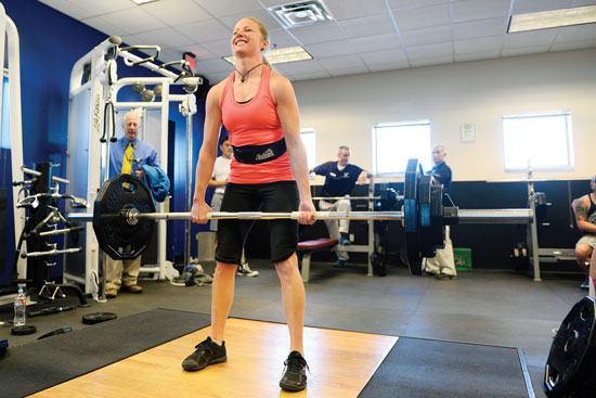 U.S. Air Force photo/Christopher DeWitt Chantel Anderson, Missile Defense Agency contractor, attempts to finish a dead lift during the annual Schriever Bench Press and Dead Lift Competition Friday at Schriever Air Force Base, Colo. Anderson took home top overall female honors for the second time in three years.