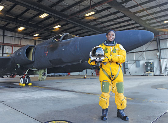 (U.S. Air Force photo by Senior Airman Bobby Cummings/Released)  Lt. Col. Merryl Tengesdal, 9th Reconnaissance Wing inspector general and U-2 Dragon Lady pilot, in front of a U-2 Feb. 9, 2015, at Beale Air Force Base, Calif. Tengesdal is the only black female U-2 pilot in history.