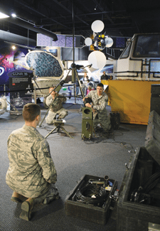 (Courtesy photo)  COLORADO SPRINGS, Colo. – Tech. Sgt. Jason Daughtrey, 21st Operations Support Squadron Weather Flight (front), coordinates set up of the TMQ 53 Tactical Meteorological Observing System with Staff Sgt. Randy Meese and Capt. Adam King, also from the 21st OSS. The team was participating in the Space Foundation Star Days event March 7.