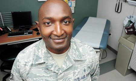 "U.S. Air Force photo/Staff Sgt. Debbie Lockhart Staff Sgt. Johnson Njenga, 21st Medical Squadron NCO-in charge of Family Health and Kenya native, poses for a photo in an exam room at the base clinic at Schriever Air Force Base, Colorado, Tuesday, July 28, 2015, for the ""I am Schriever"" diversity campaign. This campaign aims to recognize the diversity on Schriever and highlight how it makes us stronger."