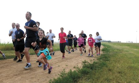 U.S. Air Force photo/Chris DeWitt Airmen from the 3rd Space Experimentation Squadron and the 50th Space Wing run with the family of Lt. Col. Zachary Owen, 3 SES commander, during the Fight Back 5K held Thursday, July 30, 2015 at Schriever Air Force Base, Colorado. The Fight Back 5K was held to bolster support for Owen and his family as he battles cancer.