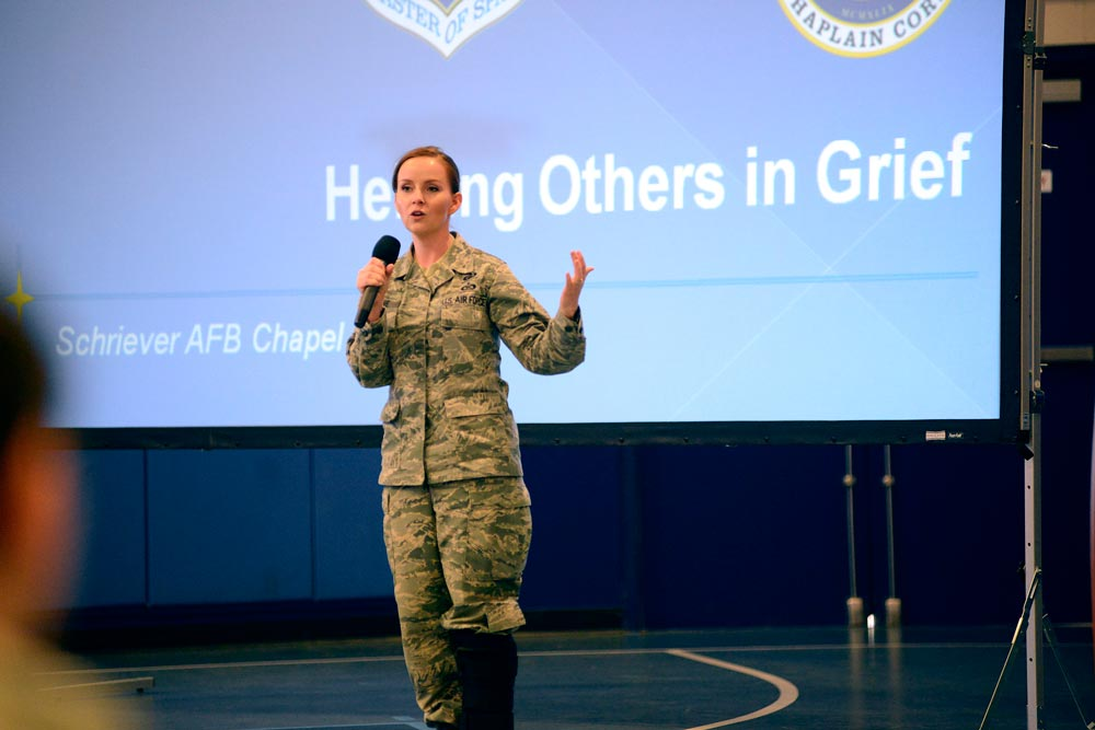 U.S. Air Force photo/Christopher DeWitt Tech. Sgt. Tawny Devine, 50th Space Wing chaplain's assistant, briefs members of Team 5-0 about helping others in grief during Wingman University in the fitness center Tuesday, Oct. 27, 2015, at Schriever Air Force Base, Colorado. Wingman University class topics ranged from stress management to Thrift Savings Plans to sleep enhancement, and each supported the four pillars of Comprehensive Airman Fitness.