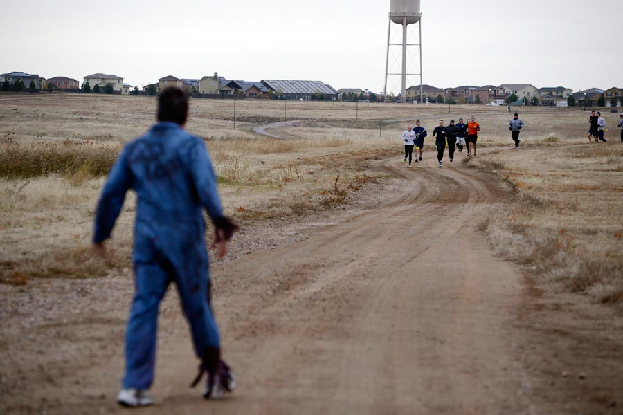 U.S. Air Force photo/Christopher DeWitt A zombie waits for runners during the Zombie Run Friday, Oct. 30, 2015, on the trail behind the fitness center at Schriever Air Force Base, Colorado. Most of the 62 participants in the run were able to survive long enough to cross the finish line.