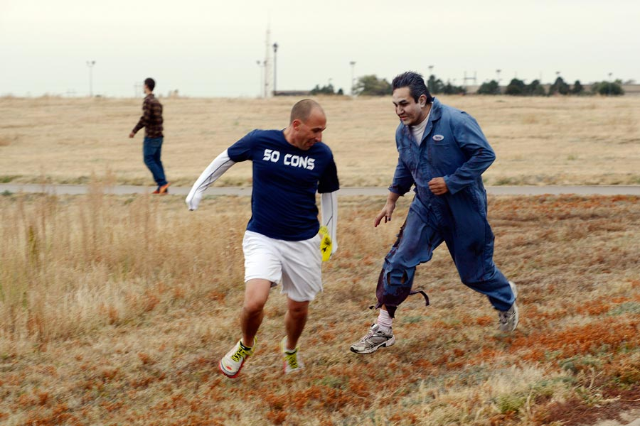 U.S. Air Force photo/Christopher DeWitt Jacob Lacefield, 50th Contracting Squadron, tries to escape from a zombie during the Zombie Run Friday, Oct. 30, 2015, at Schriever Air Force Base, Colorado. Despite the threat, most of the 62 participants in the run were able to survive long enough to cross the finish line.