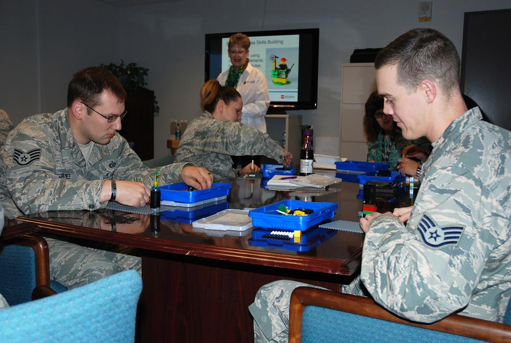PETERSON AIR FORCE BASE, Colo. — 21st Space Wing unit resiliency trainers build models using LEGO bricks to express themselves March 9, 2016. Kelly Reddin, LEGO Education global trainer shares how to use BuildToExpress techniques in building resiliency.
