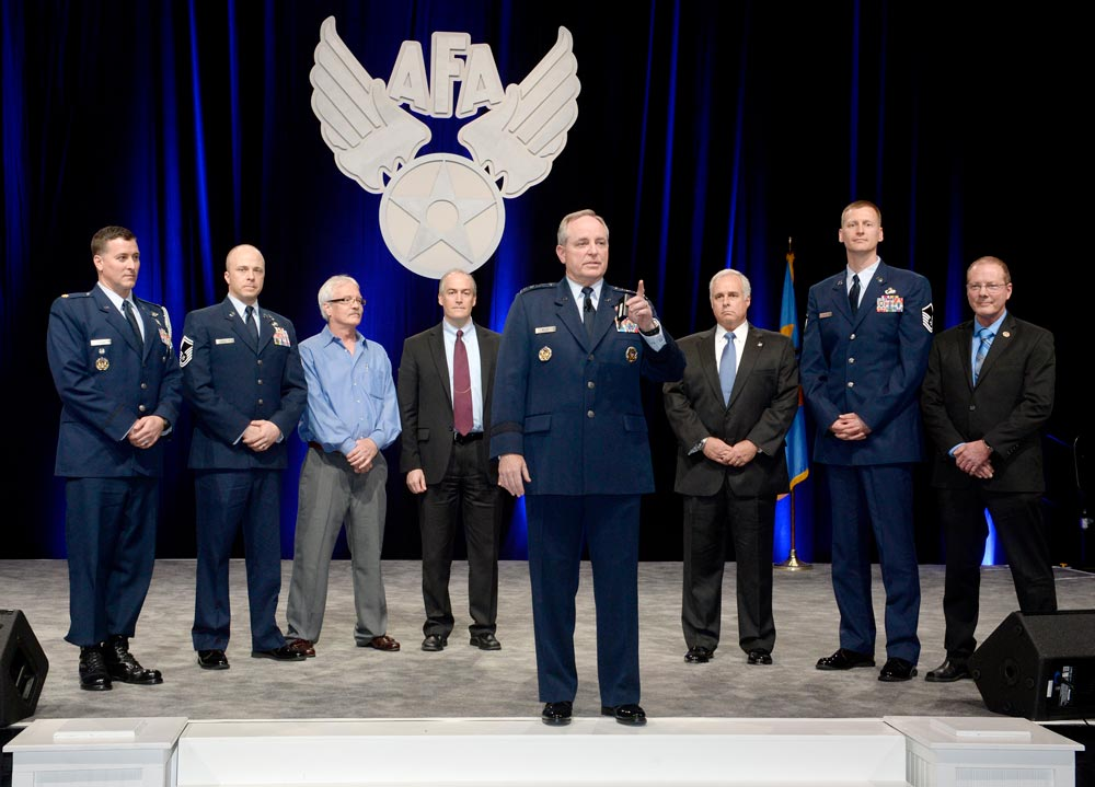 (Photo by Scott Ash) PETERSON AIR FORCE BASE, Colo. — U.S. Air Force Chief of Staff Gen. Mark Welsh speaks at the Air Force Association Air Warfare Symposium. During his speech, Welsh highlighted several Airmen stories, including one of Peterson AFB's own, Master Sgt. Gareth Davis, (second from right) 21st Comptroller Squadron financial services flight chief.