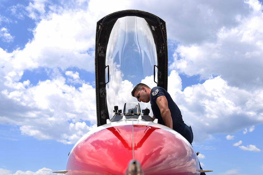 Staff Sgt. Andrew Molina, Air Force Thunderbirds aircraft structural maintainer, performs a post flight inspection at Peterson Air Force Base, Colo., on May 30, 2016. The U.S. Air Force Thunderbirds are in Colorado in preparation for a flyover at the Unites States Air Force Academy graduation.