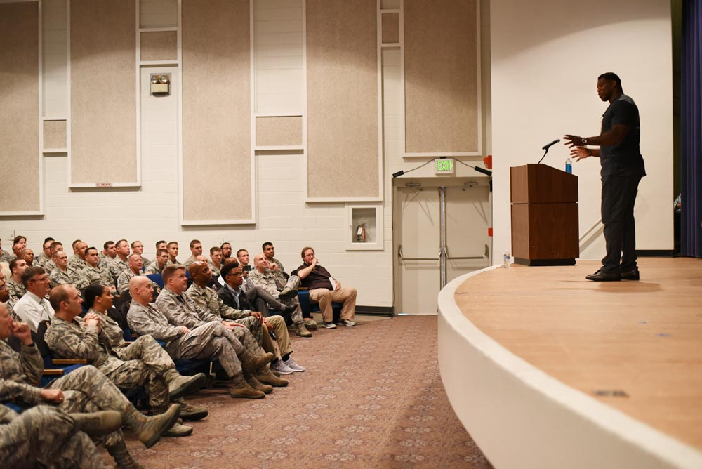 (Top) PETERSON AIR FORCE BASE, Colo. — Herschel Walker, retired NFL football player, speaks about resiliency to Team Pete in the base auditorium at Peterson Air Force Base, Colo., June 8, 2016. Walker began his professional football career with the New Jersey Generals of the United States Football League before joining the Dallas Cowboys of the National Football League.