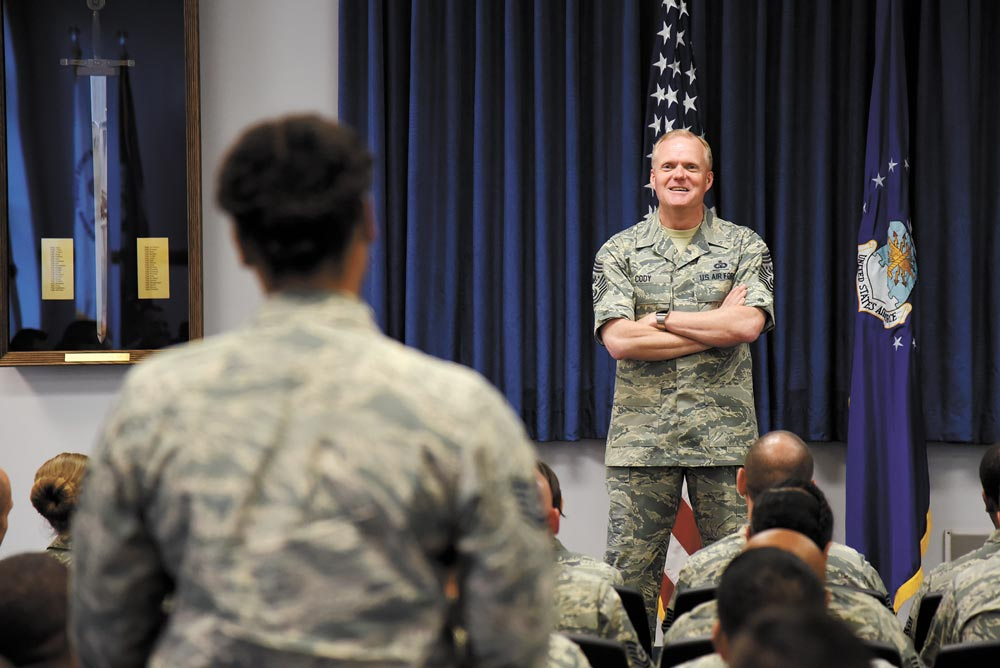 (U.S. Air Force photo by Airman 1st Class Dennis Hoffman) PETERSON AIR FORCE BASE, Colo. — Chief Master Sgt. James Cody, Chief Master Sergeant of the Air Force, answers questions from sergeants studying at the Vosler Noncommissioned Officer Academy at Peterson Air Force Base, Colo., June 29, 2016. Cody took time to answer questions regarding leadership and policy changes.