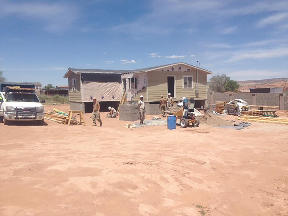 (Courtesy photo) Gallup, N.M. — Through the Operation Footprint partnership, twenty-four Air Force Reservists from the 302nd Civil Engineer Squadron helped build new homes for the Navajo Nation during Innovative Readiness Training, May 22 to June 5, 2016 in Gallup, N.M. The 302nd CES contributed to completing the construction of five new homes during their two-week training.