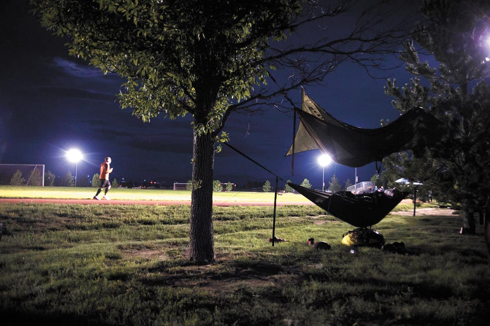 U.S. Air Force photos/Tech. Sgt. Julius Delos Reyes Master Sgt. Blair Burdick, 4th Space Operations Squadron, runs the quarter-mile track early in the morning as other participants sleep in hammocks during Schriever Challenge at Schriever Air Force Base, Colorado, Friday, Aug. 19, 2016. Participating in the challenge hit close to home for Burdick and the rest of 4 SOPS; one of their Airmen was in an accident in April. Fortunately, the family members were able to stay at a Fisher House to be with the Airman.
