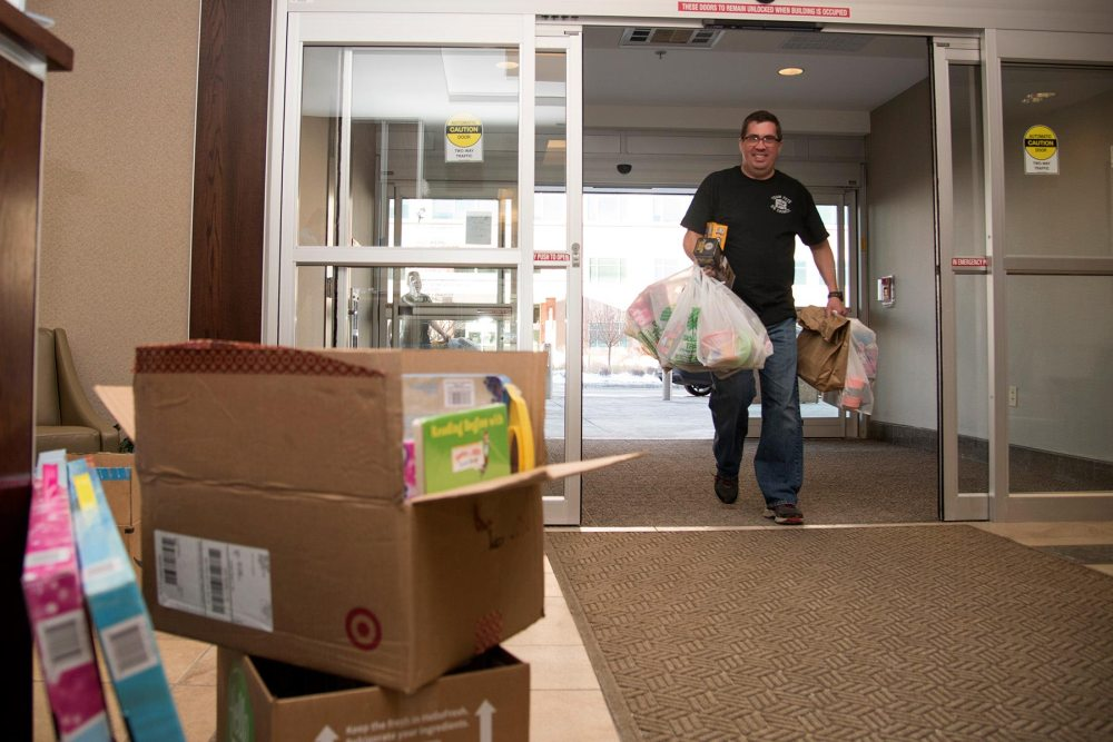 COLORADO SPRINGS, Colo. — Tech. Sgt. Kira Waller, 5/6 Club vice president from Peterson Air Force Base, Colo., lifts toys on to a cart for the Pediatric Center for Cancer and Blood Disorders at Children's Hospital Colorado, Dec. 19, 2016, in Colorado Springs, Colo. This year the 5/6 Club was able to collect approximately $3000 worth of toys from members of Team Pete and the U.S. Air Force Academy. The toys are used for holiday gifts and for use throughout the year while patients receive treatment.