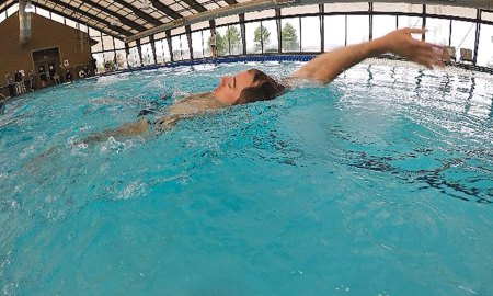 U.S. Air Force photo/Chris DeWitt Matthew Cork, 3rd Space Experimentation Squadron flight commander, swims backstroke for the 400 meter portion of the triathlon at Schriever Air Force Base, Colorado, Friday, Aug. 4, 2017. This was Cork's second time competing in this Schriever event, and he finished first with a time of 1:13:46.