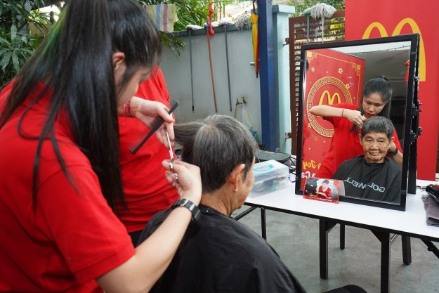 Residents getting their hair trimmed at Rumah Charis Puchong
