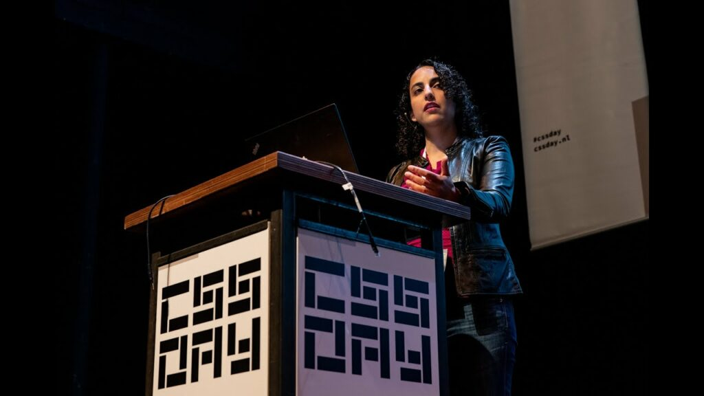 Elike Etemad speaking in front of a podium for CSS Day.