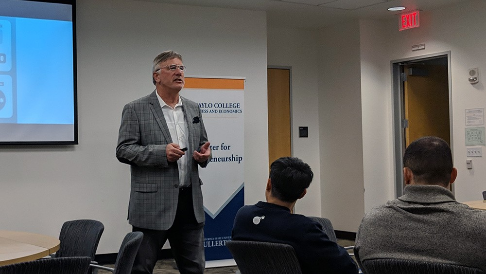 Founder and CEO of Pedego Electric Bikes, Don DiCostanzo, gives a talk on his company's marketing mix to CSUF Entrepreneurship students