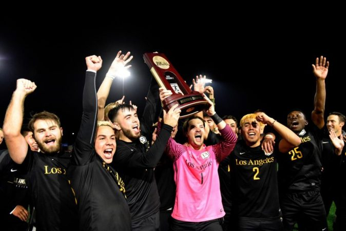 Cal+State+LA+men%E2%80%99s+soccer+team+celebrate+winning+the+NCAA+quarterfinals+with+their+own+trophy.+Cal+State+LA+will+transition+to+the+NCAA+Championship+semifinal+in+Pittsburgh%2C+Pennsylvania.