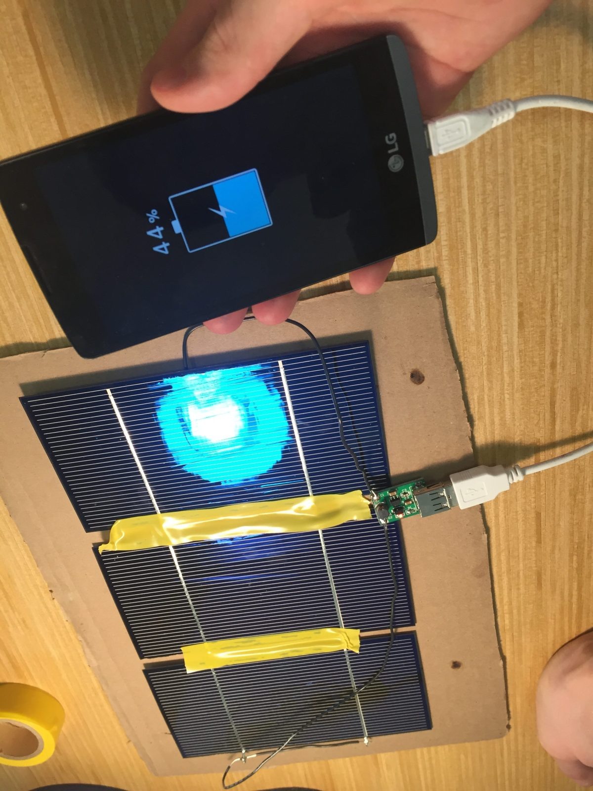 Solar cells charging an Android phone