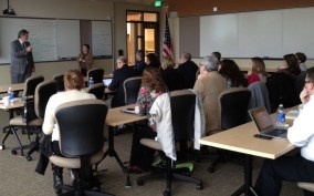 Jeff Thompson and Barbara Martin discuss project planning and issues with Community Colleges of Spokane SMEs.