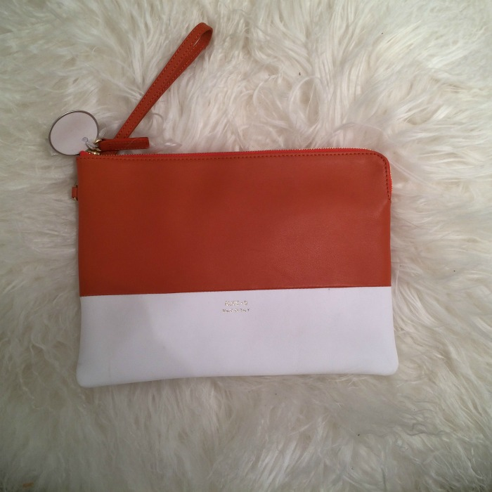 Orange and white purse