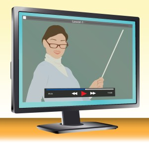 this image shows a computer screen displaying a video paused on an instructor teaching at a blackboard.