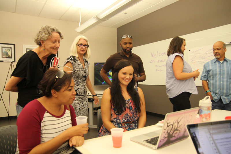 Group of faculty around a laptop