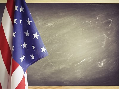 American flag and chalkboard