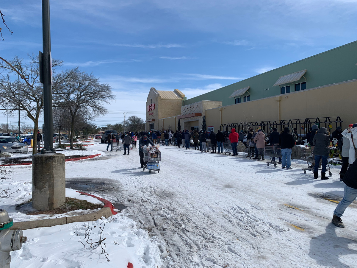 A long line forms outside of HEB grocery store in Georgetown, Texas on Feb. 16 after a snowstorm. (PorqueNo Studios via Shutterstock)