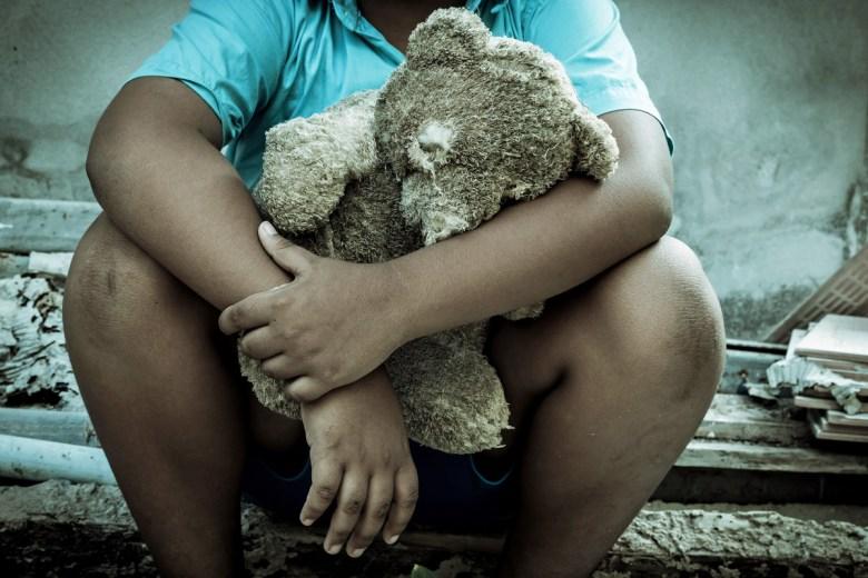 Sad boy with teddy bear. (Pikul Noorod via Shutterstock)