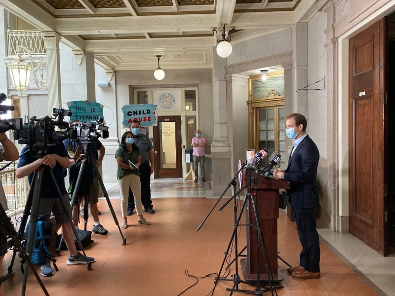 A photo of Hartford Mayor Luke Bronin at a press conference taken from his Twitter profile