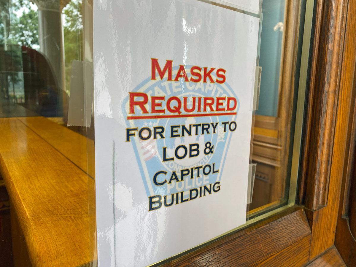 capitol covid mask sign