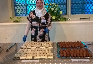 woman behind table with Syrian street food