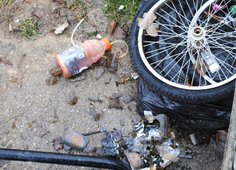 Ingredients used for cooking methamphetamines litter the ground. Such parts are often found with small cooking operations, making it difficult for police to track.