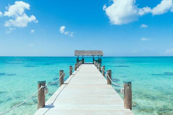 Island-Pier-On-Perfect-Tropical-Beach-With-Blue-Water