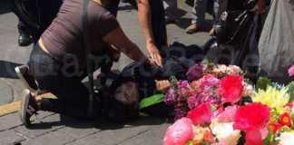 mujer policia baleada