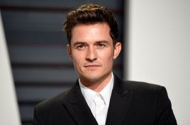 """FILE - This Feb. 26, 2017 file photo shows Orlando Bloom at the Vanity Fair Oscar Party in Beverly Hills, Calif. Bloom and singer Katy Perry are breaking up after about a year together. Representatives for Perry and Bloom released a statement Wednesday saying: """"... we can confirm that Orlando and Katy are taking respectful, loving space at this time."""" (Photo by Evan Agostini/Invision/AP, File)"""