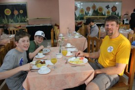 From Left to Right: Tate, Eli, and Dave Bostwick enjoy breakfast at the Bella Habana Hotel.