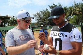 Team Vermont parent Ben Rinehart gets a ball signed by starting Cuban National Team and Havana Industriales catcher Frank Camilo Moregon. Moregon threw the ceremonial first pitch in the game against Cerro.