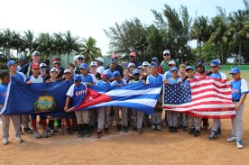 The players and coaches pose for a post-game photo with the flags of our two nations and the state of Vermont.,