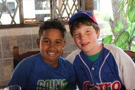 Ozzie Kost (Right), wears his new jersey from the Cerro baseball team, given to him by his Cuban counterpart.