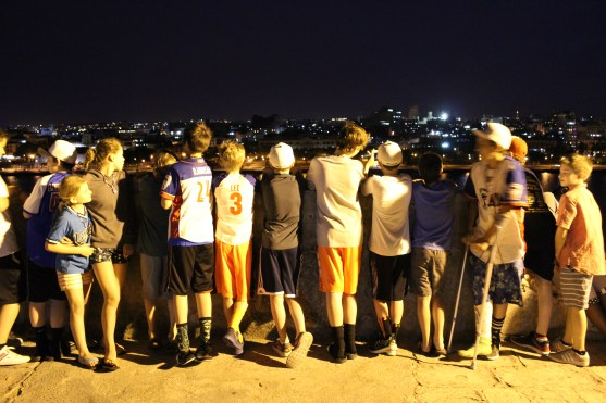 The team looks at the city skyline from the wall of a 17th century Spanish fort.