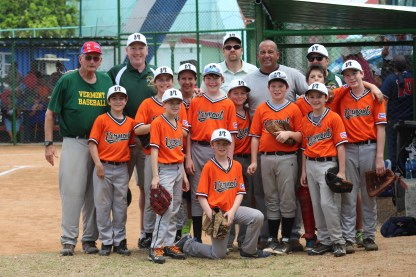 The Vermont team poses with Cuban baseball great Yosvani Aragon.