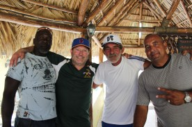 Tom Simon (second from left) and Cuban baseball great Yosvani Aragon (far right), pose for a photo with members of the local baseball community. Aragon was a pitcher for Gallos de Sancti Spiritus between 1997 and 2007 and one of the best in Cuban history.