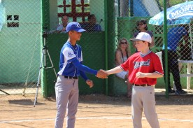 Ollie Pudvar (right), shakes hands with the first place competitor in the base running skills competition.