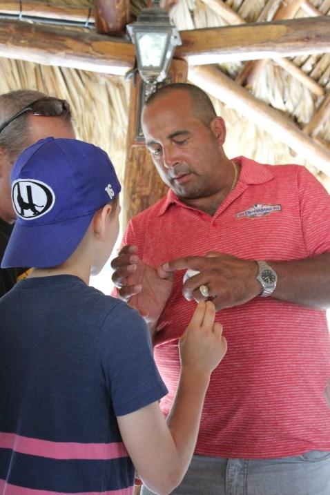 Star Cuban pitcher Yosvani Aragon gives Vermont player Nolan Simon a pitching lesson.