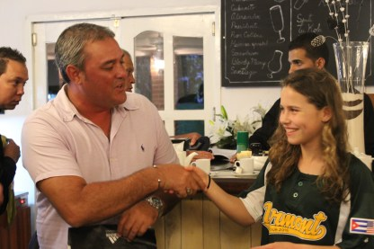 Our translator, Lester Bolla, shakes the hand of Vermont player Anna Jenemann after receiving a Vermont baseball t-shirt.