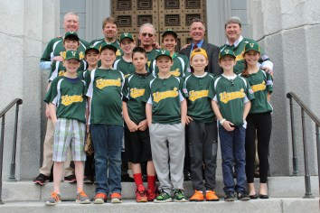 Lieutenant Governor Phil Scott poses for a photo along with the players and coaches of the Vermont baseball team that travelled to Cuba this April.